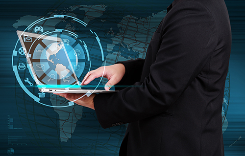 Businessman holding a laptop with globe and icon application on